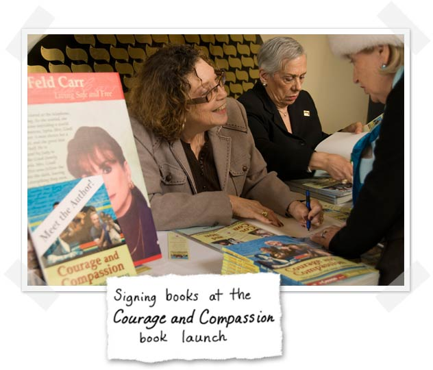 Rona Arato signing books at the Courage and Compassion book launch